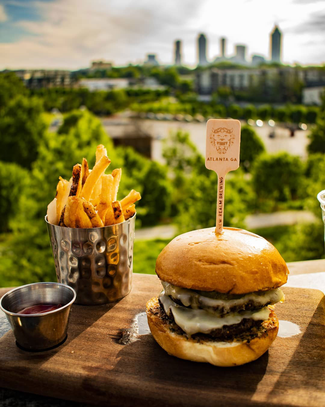 Burger and fries at New Realm Brewery overlooking the Atlanta BeltLine. Photo by @wizardgreencraft