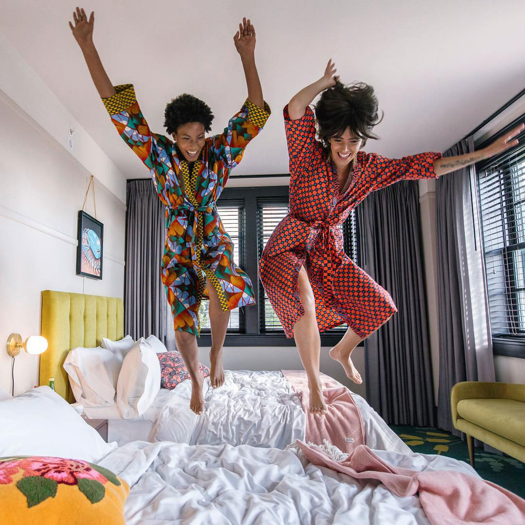 Women jumping on beds at the Hotel Clermont in Atlanta. Photo credit Hotel Clermont