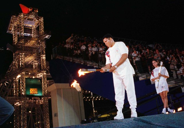 Former world heavyweight boxing champion Muhammad Ali lighting the Olympic Flame at the Opening Ceremony of Atlanta 1996.