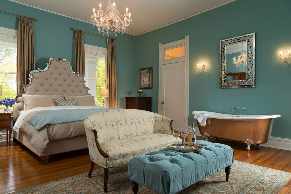 Katherine's Mirror Image Grand Suite at Twelve Oaks B&B features a king size bed and claw foot tub.