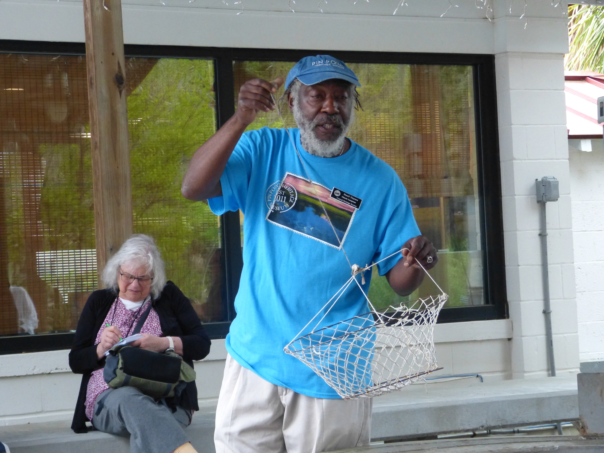 Herman Haynes shows how crabs were caught at the A.S. Varn & Son Oyster and Crab Factory. Photo by Kalin Thomas