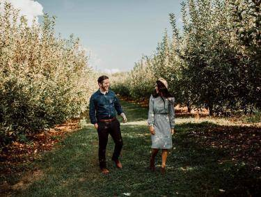 Couple at B.J. Reece Orchards in Ellijay, Georgia. Photo by Steffy Montes, @steffyfortner