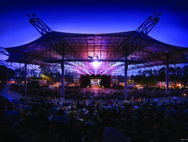 Ameris Bank Amphitheater at night with purple lights