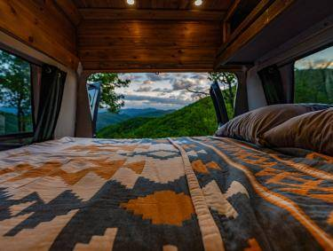 Live More Campervan interior at sunrise