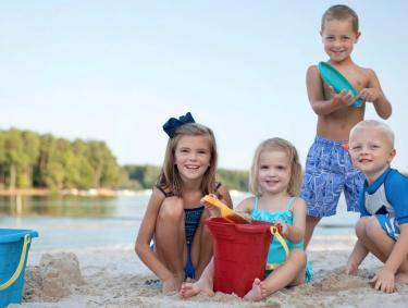 Children playing at the beach at Lake Oconee