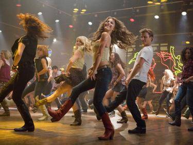"Julianne Hough as Ariel and Kenny Wormald as Ren dance at the Electric Cowboy in ""Footloose"