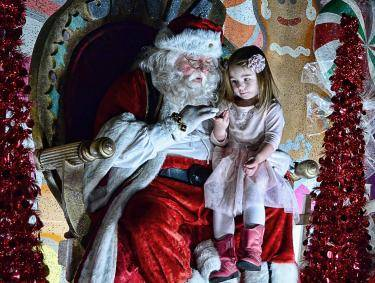 Santa with girl at Thomasville's Victorian Christmas Festival