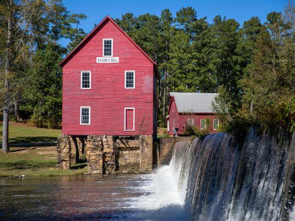 Starr's Mill with waterfall in Fayetteville, near Senoia, Georgia. Photo by @benjamingalland