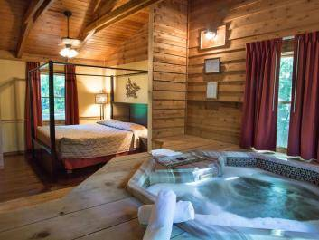 King canopy beds, hot tubs and stone fireplaces are standard equipment with all of our newly remodeled cabins for couples.