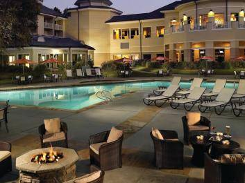 Resort-style pool deck with firepits.