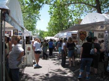 Festival attendees explore the many quality arts and crafts booths around the square in downtown Dahlonega, GA.