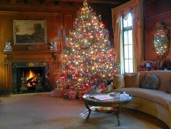 The living room Christmas tree decorated with traditional ornaments and real tinsel.