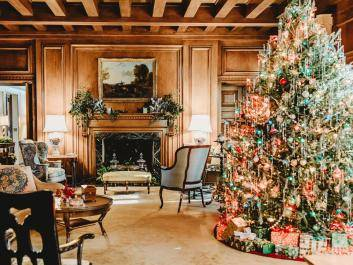 The living room decorated for Christmas, featuring a 1940s era live Fraser fir Christmas tree.
