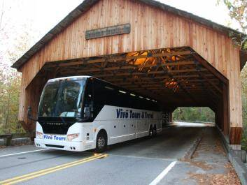 Tour bus passing through the Haralson Mill Covered Bridge in Conyers