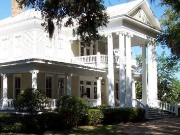 Fronted by large oaks, the Neel House is a breathtaking example of classic southern architecture!