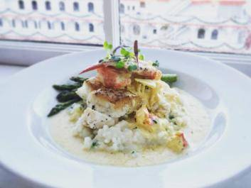 Pan seared wreck fish over infused risotto with lobster and saffron cream sauce