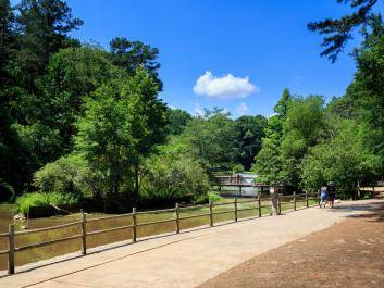Memorial Park in Athens features a lovely, wooded landscape, paths, and pond