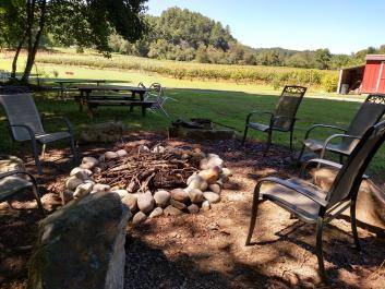 Enjoy sipping wine by the firepit on the river.