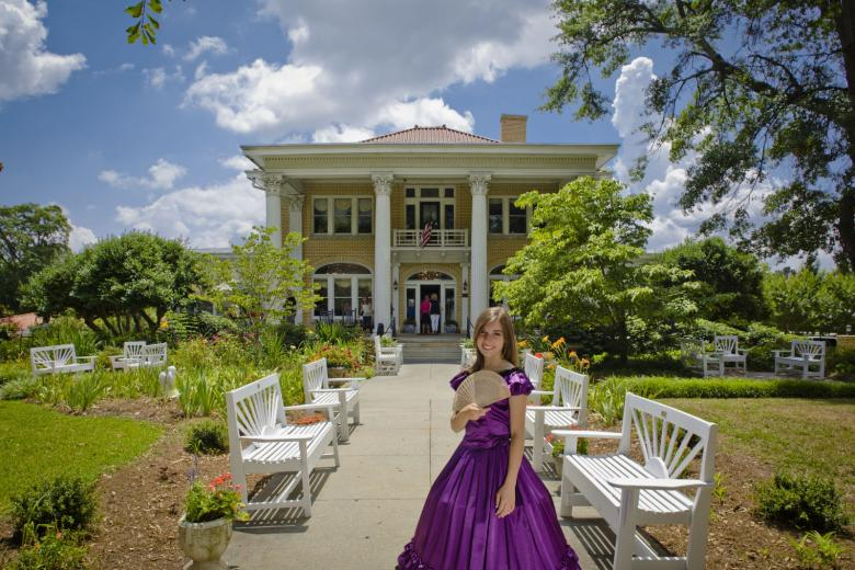 A model stands in an Antebellum-era dress outside the Blue Willow Inn in Social Circle, Georgia