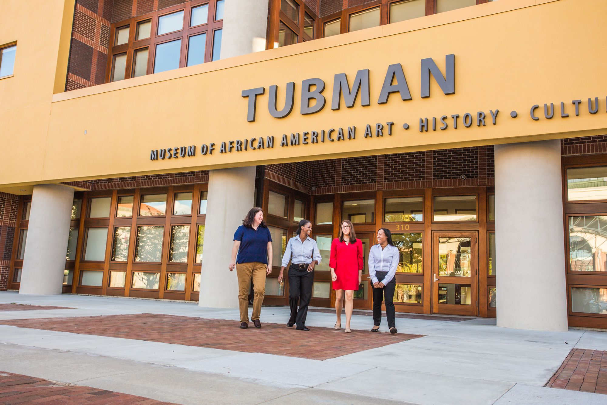 Four women walk outside the Tubman Museum in Macon, Georgia